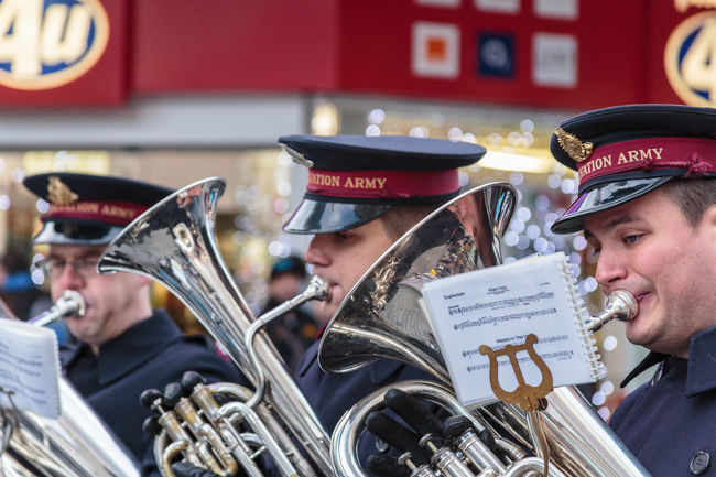 Three members of the Salvation army bras band playing instruments outside in the city centre of Birmingham Adults Only Brass Instruments Christmas City City Life Day Festive Festive Season Headwear Musical Instrument Musicians Only Men Outdoors Red#Hair#Smile#  Salvation Army Sheet Music Three Men Three People Uniforms