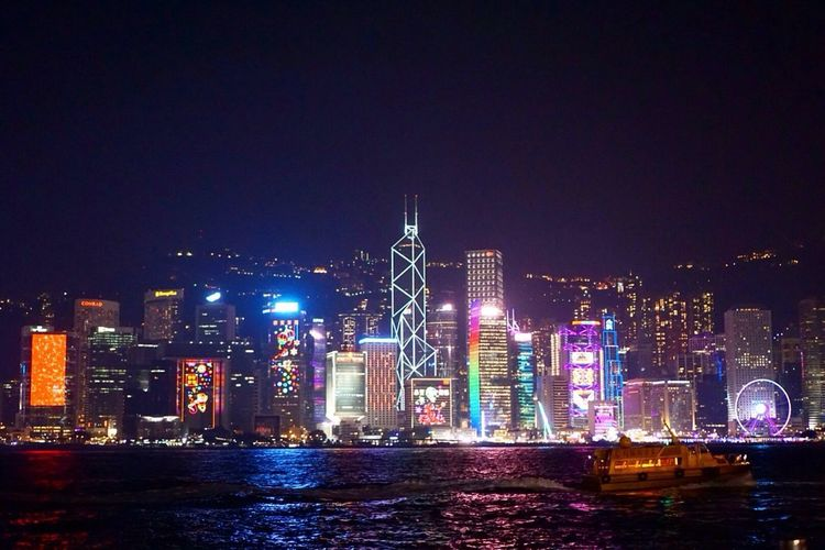 City Illuminated Night Architecture Skyscraper Cityscape Waterfront Water Urban Skyline Modern River Outdoors No People Downtown District Travel Destinations HongKong Victoriaharbour Sky Nature