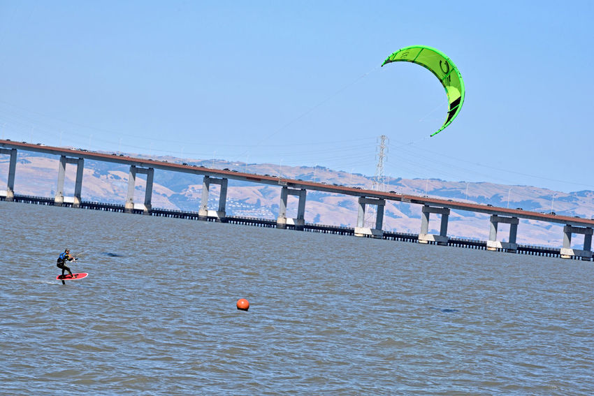 Kiteboarding In San Mateo 16 San Francisco Bay San Mateo Bridge Kiteboarder Kite Surfing Kiteboarding Wind Power Sail Power Colorful Sails Water Watersports Aquactic Sports Enjoying Life East Bay Hills Power Towers Power Lines Riding The Wind Course Marker Bridge Span Sports Photography