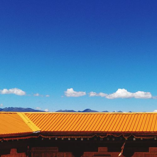 Low angle view of roof against blue sky