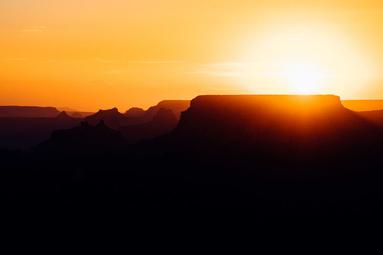 Silhouette Rock Formations Against Sky During Sunset At Grand Canyon National Park