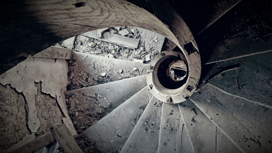 High Angle View Of Spiral Abandoned Stairs