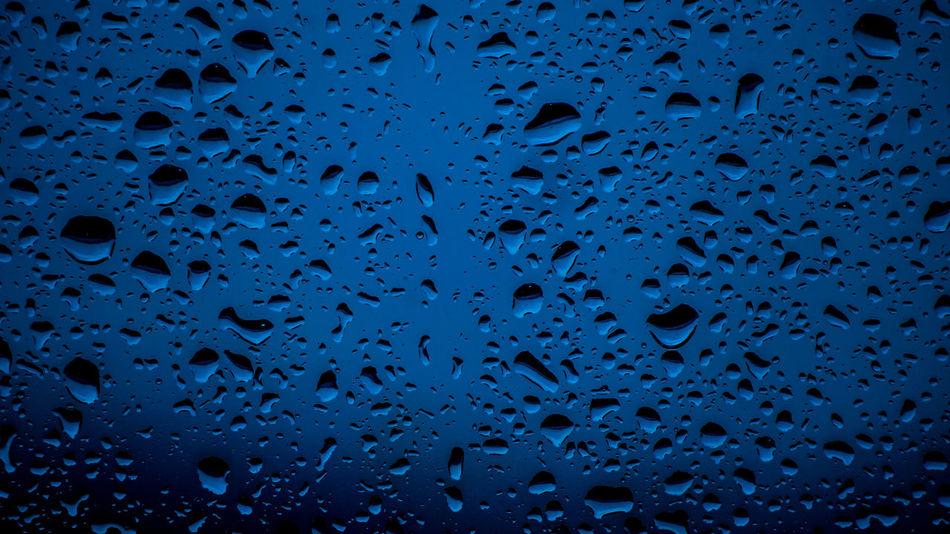 Rain Raindrops Rainy Days Backgrounds Blue Blue Sky Close-up Day Drop Freshness Full Frame Indoors  No People RainDrop Water Wet Window