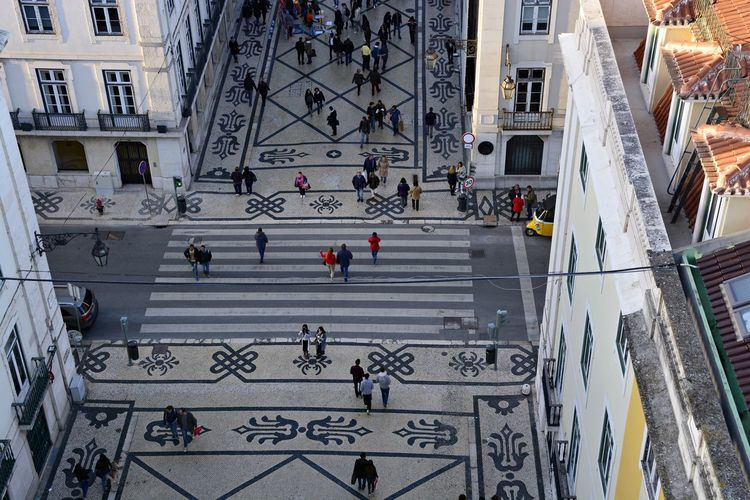 High angle view of people walking in street in city