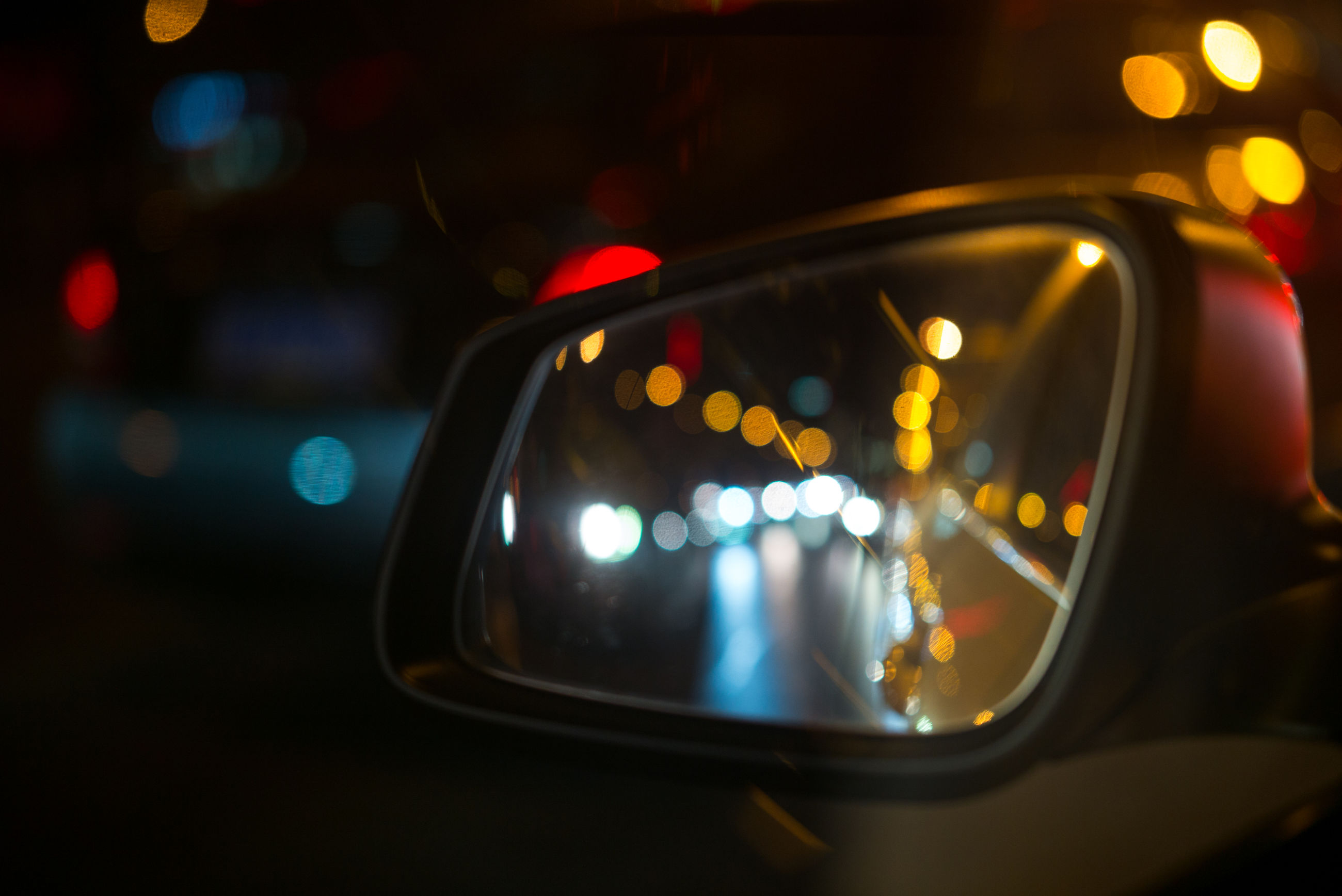 transportation, land vehicle, mode of transport, car, illuminated, night, glass - material, close-up, vehicle interior, transparent, reflection, headlight, car interior, side-view mirror, part of, street, blurred motion, travel, speed, on the move