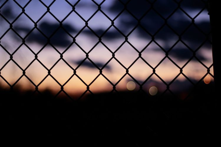 Caged beauty Chainlink Fence Fence Protection Metal No People Outdoors Sunset Sky Close-up Scenics Nature Michigan EyeEmNewHere The Week On Eyem EyeEm Art Is Everywhere