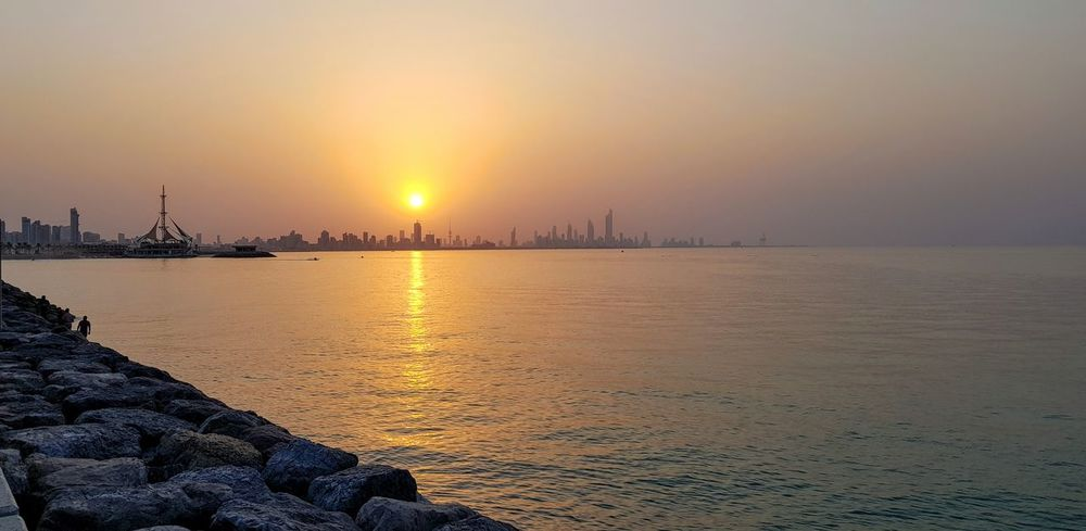 Sunset, Salmiya, Kuwait Water Cityscape Nautical Vessel Urban Skyline Sea Beauty Sunset Beach Horizon Multi Colored Seascape Romantic Sky Trawler View Into Land Recreational Boat Coast Moody Sky EyeEmNewHere