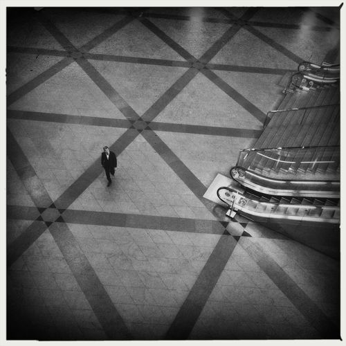 High Angle View Of Businessman Walking In Subway Station