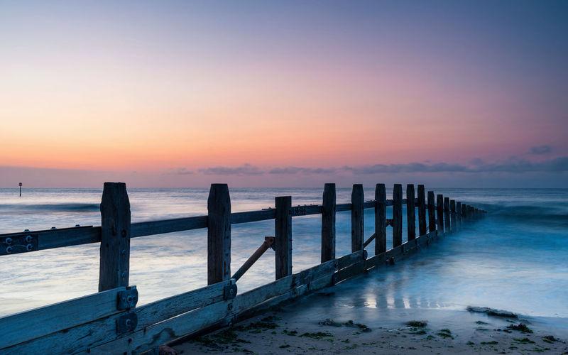 Sunrise and beach in dawlish warren, devon, england