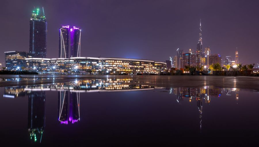 EyeEm Selects EyeEm Best Shots Dubai Architecture Building Exterior Built Structure Night City Illuminated Reflection Office Building Exterior Building Urban Skyline Tall - High Cityscape Waterfront Sky Water