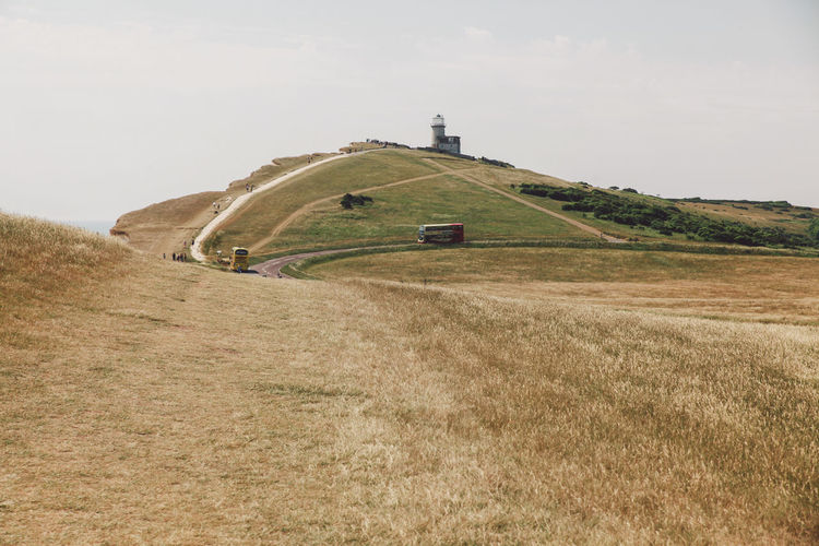 Architecture Beachy Head Beachyhead Built Structure Field Grass Grassy Hill Holiday Landscape Mountain Nature No People Non-urban Scene Outdoors Remote Rural Scene Scenics Sky Summer Tranquil Scene Tranquility Travel The Great Outdoors - 2016 EyeEm Awards The Great Outdoors With Adobe Lost In The Landscape