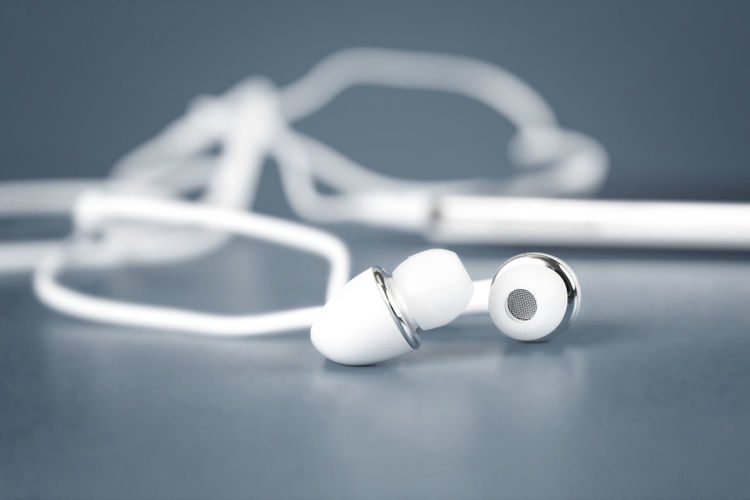 Close-up of in-ear headphones on table