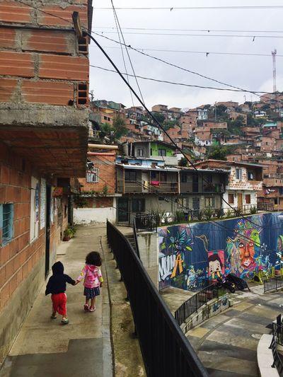 Comuna 13 Kids Newbeginning Street Neighborhood Childhood Love Innosence Simple Colombia Family Brothers Holding Hands Happiness Purelove Graffiti Playground
