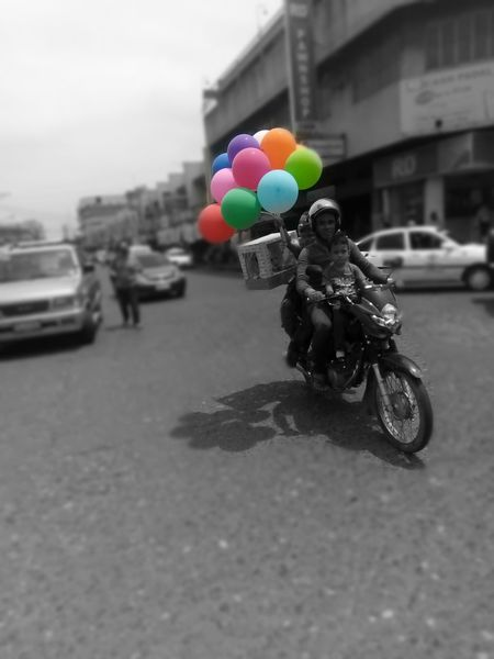 A handful of Celebration The Still Life Photographer - 2018 EyeEm Awards Family Matters City Balloon Car Road Multi Colored City Life Stationary City Street Street