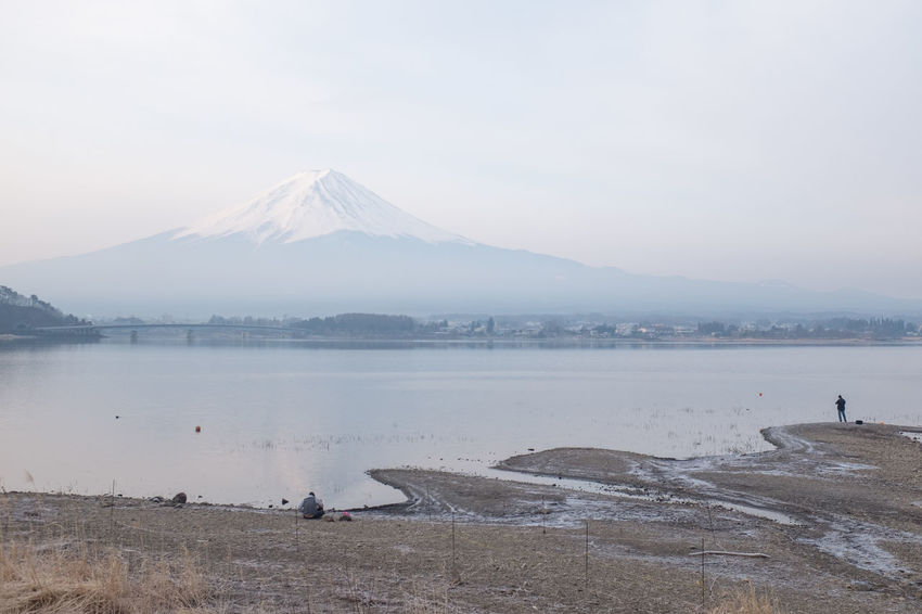 Beach Beauty In Nature Distant Famous Place Fog Fuji International Landmark Majestic Mountain Mountain Peak Mountain Range Natural Landmark Nature Non-urban Scene Physical Geography Scenics Sea Shore Sky Tourism Tranquil Scene Tranquility Travel Destinations Vacations Water