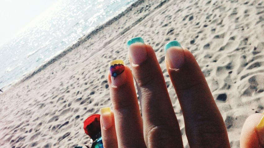 Beach Human Body Part Sand Nail Polish One Person Human Finger Human Foot Personal Perspective Human Leg Barefoot Real People Day Close-up Fingernail Human Hand Only Women Adult Focus On Foreground Women Lifestyles