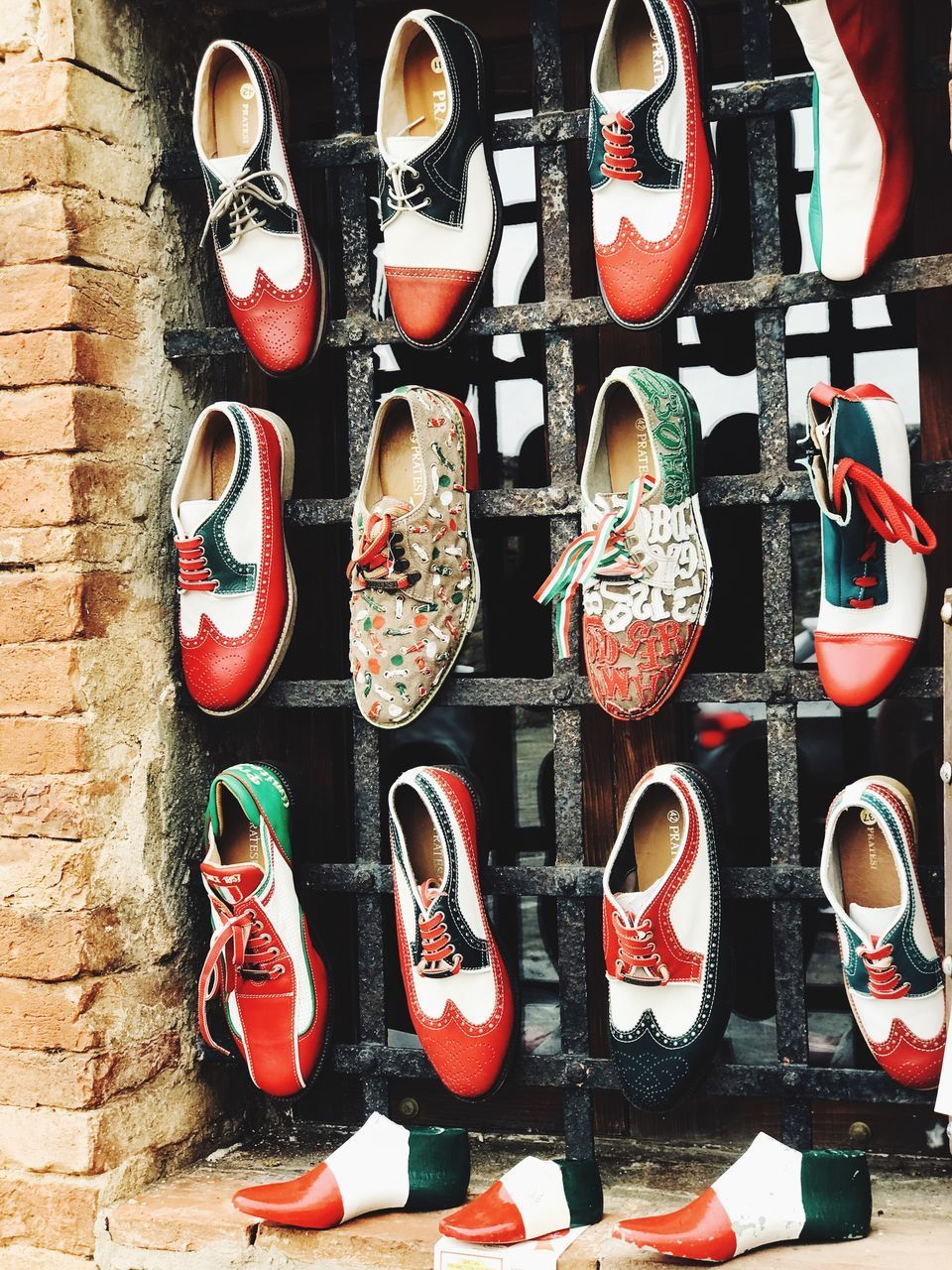 no people, choice, still life, arrangement, variation, shoe, large group of objects, for sale, red, retail, in a row, indoors, close-up, multi colored, day, fashion, order, pair, retail display, compatibility