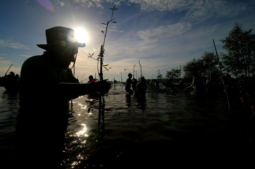 in Water HUAWEI Photo Award: After Dark Water Occupation Silhouette Men Working Sky