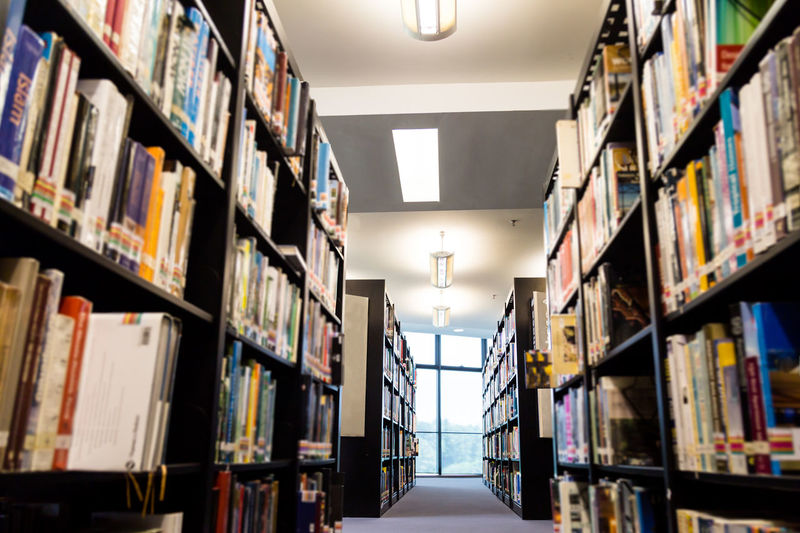 Library aisle with loads of books, references and education material Abundance Aisle Arrangement Book Bookshelf Education Indoors  Large Group Of Objects Learning Library Literature No People Order Publication Shelf Variation