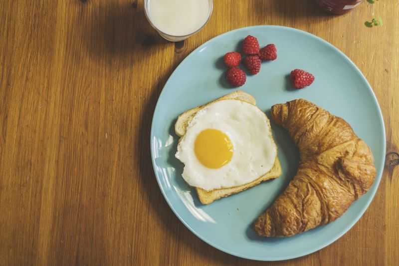 High Angle View Of Breakfast With Milk Served On Table