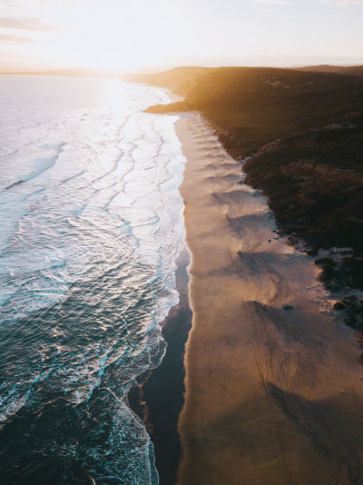 Water Sea Land Beauty In Nature Aquatic Sport Beach Nature Surfing Motion Sport Scenics - Nature Outdoors Wave Sunset Day Sky High Angle View Power In Nature Aerial View Drone  Coastline Coast Waves