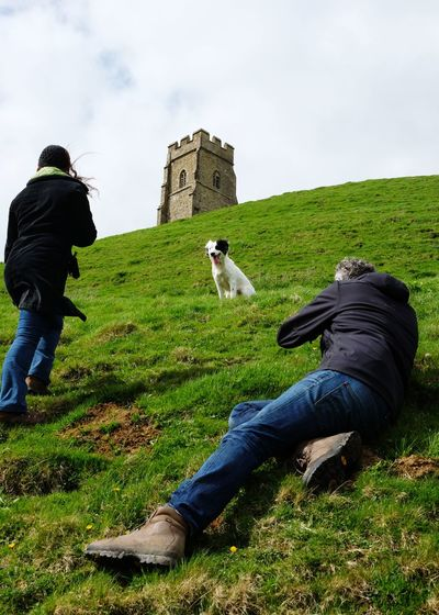 my dog won a photo shoot! Dog Sprollie Glastonbury Tor Glastonbury Photoshoot Model Full Length Men Sky Grass Cloud - Sky Green Color Hill Hiking Slope