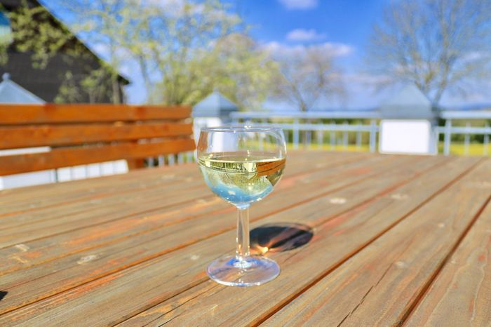 Table Food And Drink Focus On Foreground Drink Alcohol Refreshment Drinking Glass Wood - Material Outdoors No People Wineglass Wine Close-up Day Sky Freshness Tree Nature