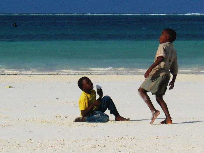 2006 Beach Boys Childhood Dancing Day Full Length Horizon Over Water Outdoors Real People Sand Sea Shore Two People Water Zanzibar