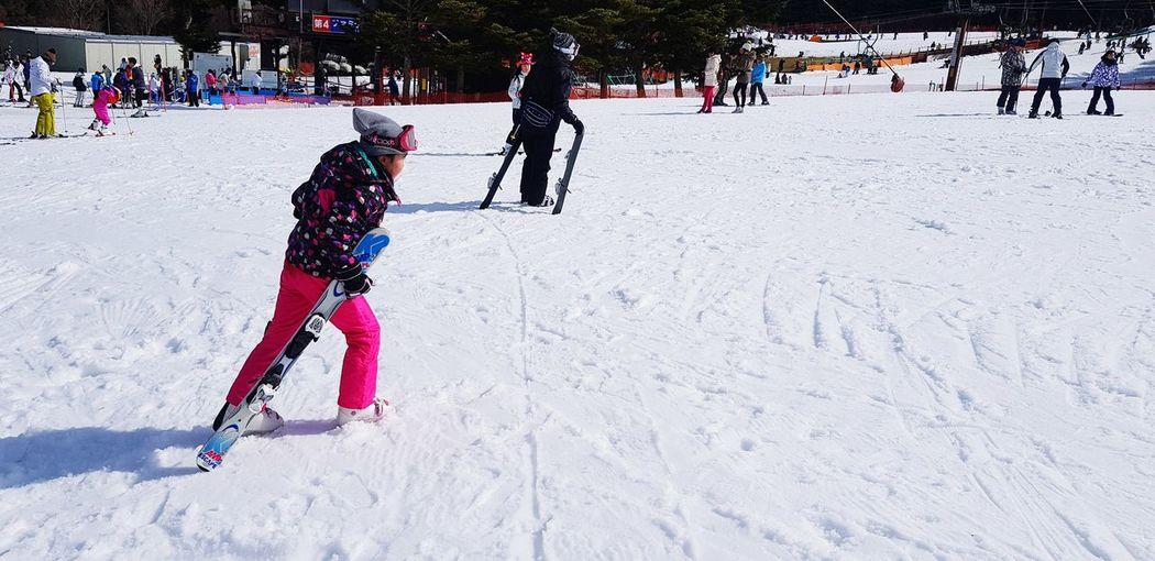 People skiing on snow land