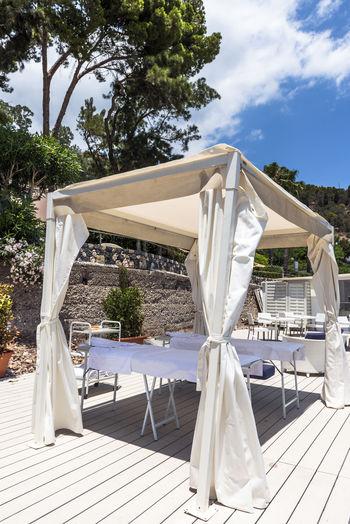 A spa on the beach in Taromina on Sicily, Italy Beauty In Nature Day Gazebo Italy Luxury Nature No People Outdoors Sky Spa Summer Sunlight Taormina Tranquility Treat Tree Vacations