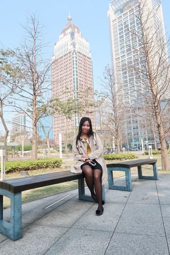 Loving this cold weather Only Women One Woman Only One Person City Sitting Full Length Adults Only Adult One Young Woman Only Young Adult People City Life Long Hair Skyscraper Day Women Outdoors Young Women Confidence  Beautiful Woman