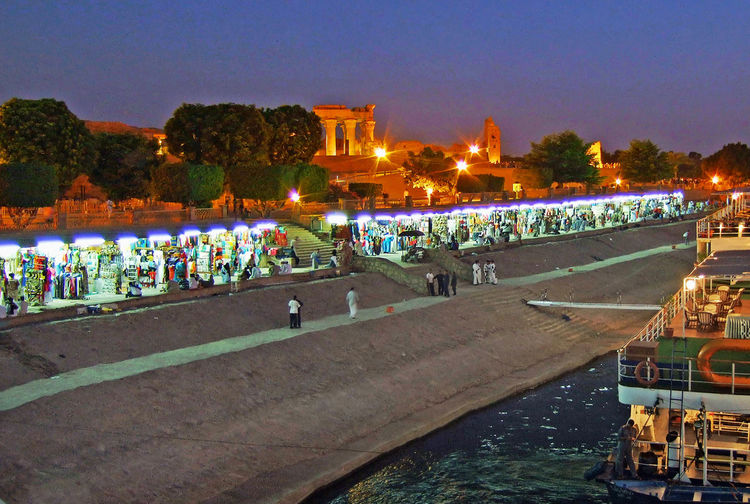 Egypt Kom Ombo Temple Built Structure Crowd Dusk Illuminated Illuminations Of Night Marketplace Mode Of Transportation Nautical Vessel Night Real People Sky Tourism Travel Destination Water