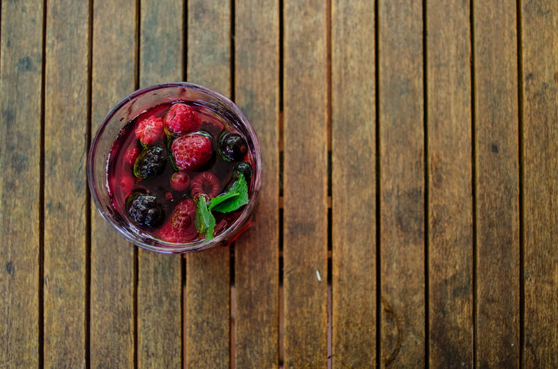 summer, holiday, feeling, cold lemonade with ice in a hot summer day at the garden Beverage Cube Ice Lemonade Music Orange RedBerry  Refreshment Tea Wood Beach Blueberry Chill Citrus Fruit Cold Fruit Garden Glass Lemon Mint Raspberry Strawberry Summer Table Water
