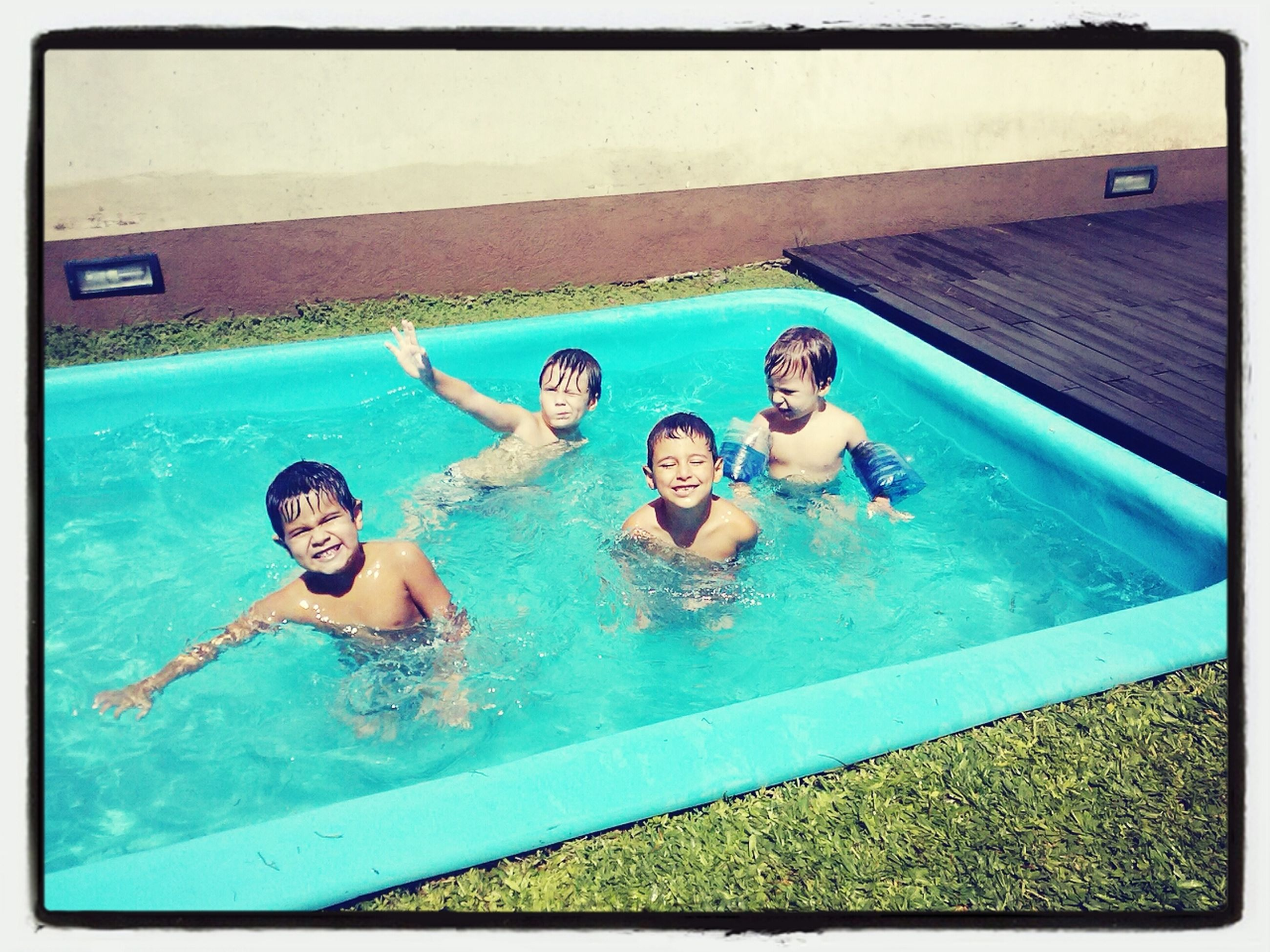 lifestyles, leisure activity, transfer print, swimming pool, auto post production filter, water, enjoyment, person, childhood, high angle view, fun, togetherness, blue, happiness, elementary age, boys, smiling