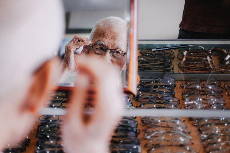 Portrait of man working in store