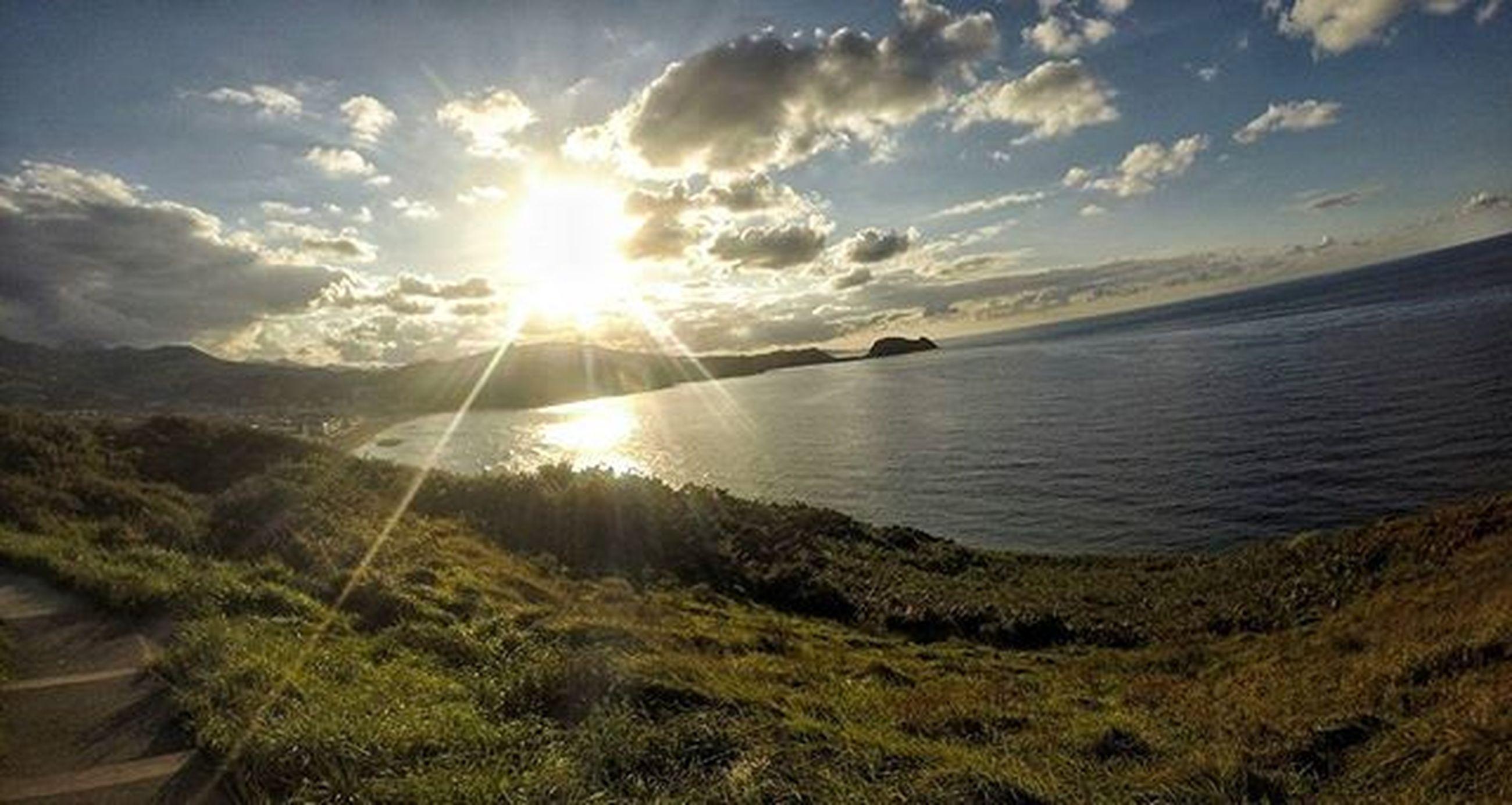sun, tranquil scene, tranquility, sunbeam, sky, scenics, sunlight, water, beauty in nature, lens flare, nature, sunset, cloud - sky, idyllic, reflection, grass, lake, landscape, non-urban scene, cloud
