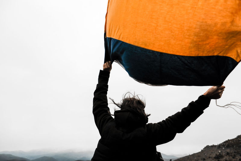 Buddha Buddhist Orange Red Woman Blue Bouddha  Buddhism Buddhist Flag Colorful Drapeau Flag Fog Fuji Fujifilm Fujixpro2 Landscape Mountains Mountains And Sky One Person Outdoors Sky White Woman Portrait Yellow
