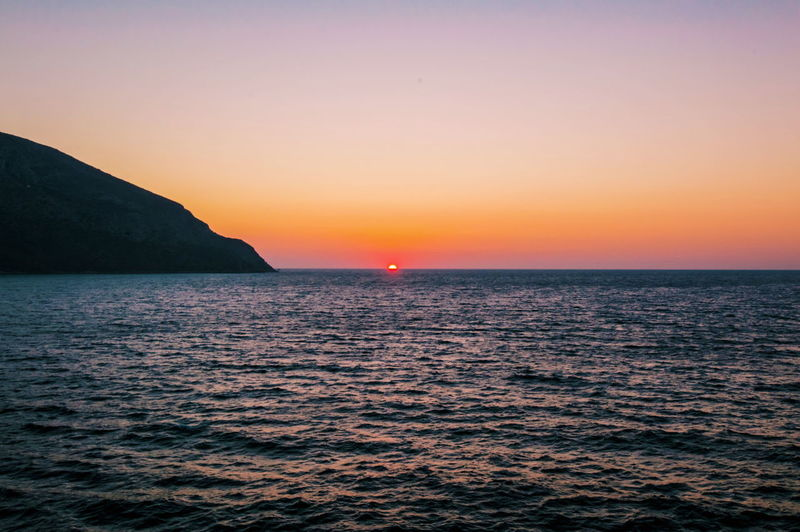 Sun, go to bed! Sea Scenics Sunset Tranquil Scene Horizon Over Water Water Beauty In Nature Tranquility Idyllic Clear Sky Orange Color Nature Seascape Non-urban Scene Calm Kalymnos Greece