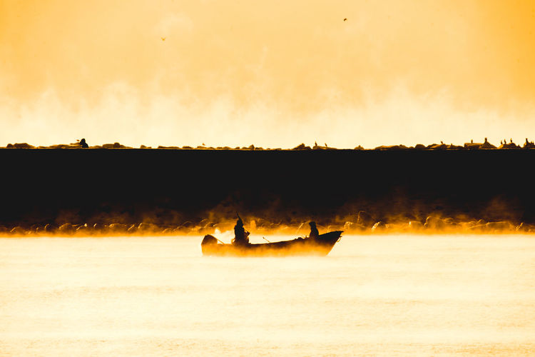 Silhouette boat in a lake