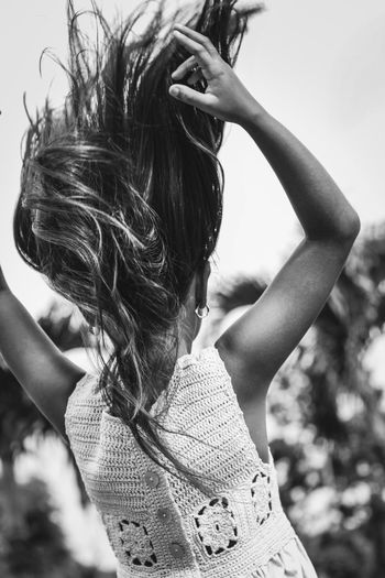 Rear view of girl tossing hair in park