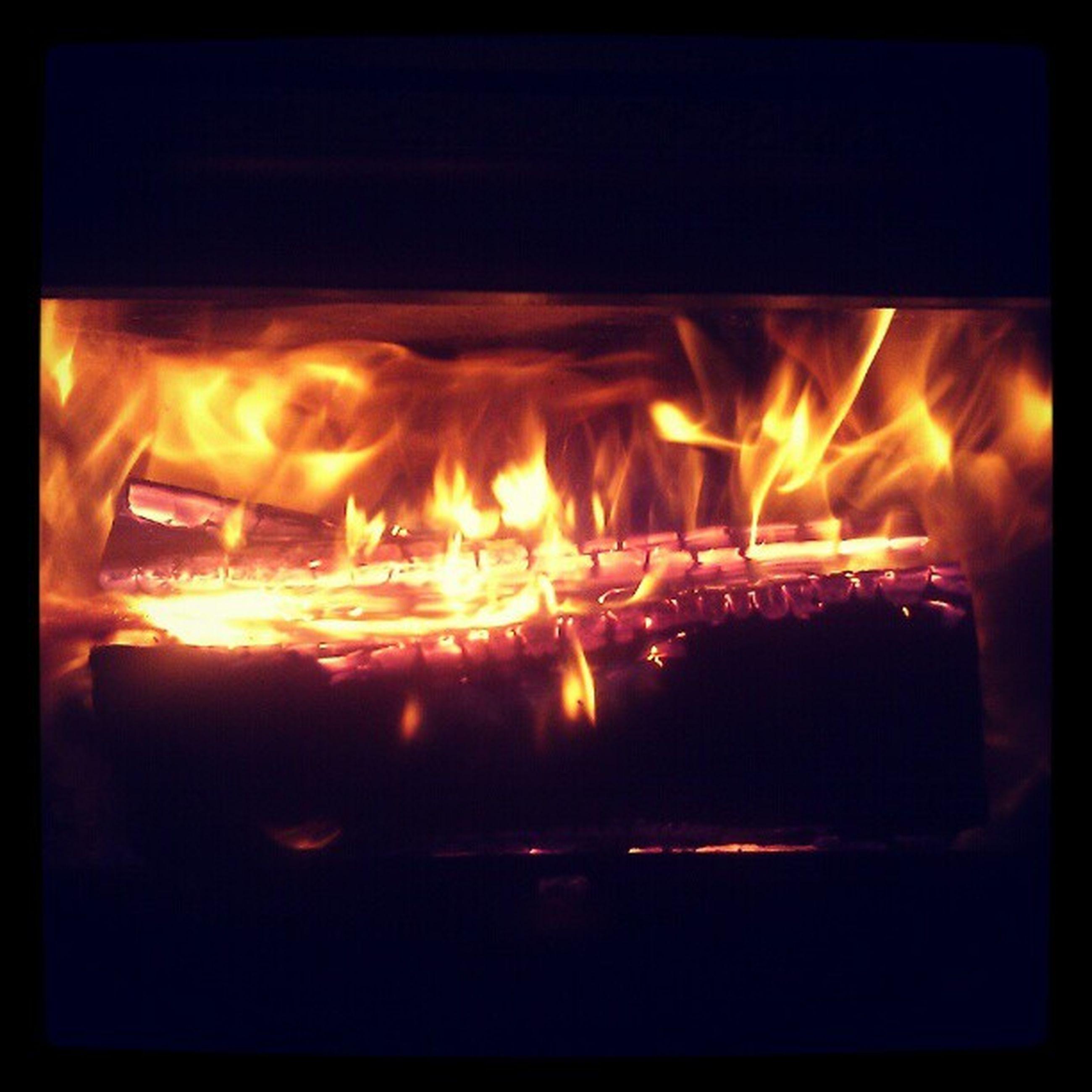 flame, burning, fire - natural phenomenon, heat - temperature, glowing, transfer print, fire, illuminated, night, indoors, bonfire, firewood, heat, auto post production filter, close-up, motion, light - natural phenomenon, orange color, campfire, dark