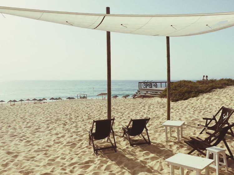 Horizon Over Water Sea Beach Empty Chair Water Absence Sand Tranquil Scene Relaxation Tranquility Sunny Shore Scenics Vacations Sunshade Day Outdoors Sky Coastline Comporta, Portugal