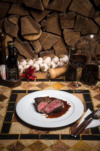 Beef Beef Steak Cooking Dinner Alcohol Beefsteak Day Food Food And Drink Freshness Indoors  Meat No People Place Setting Plate Restaurant Serving Dish Spice T-bone T-bone Steak Table Wine Wineglass
