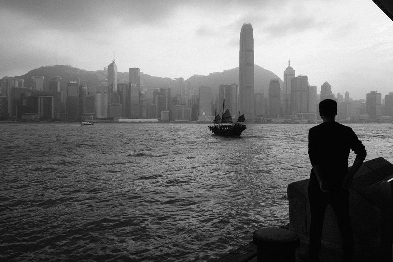 Bon Voyage City Real People Travel Destinations Outdoors Silhouette One Man Only Architecture Hong Kong City Hong Kong Skyline Hongkong Photos Hong Kong Harbour Street Photography Streetphotography_bw Black And White Architecture Welcome To Black The Street Photographer - 2017 EyeEm Awards