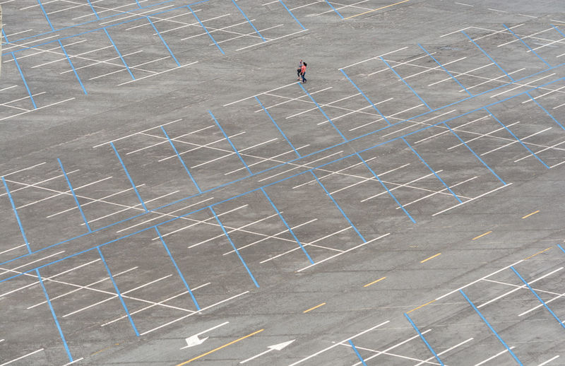 High angle view of man walking on soccer field