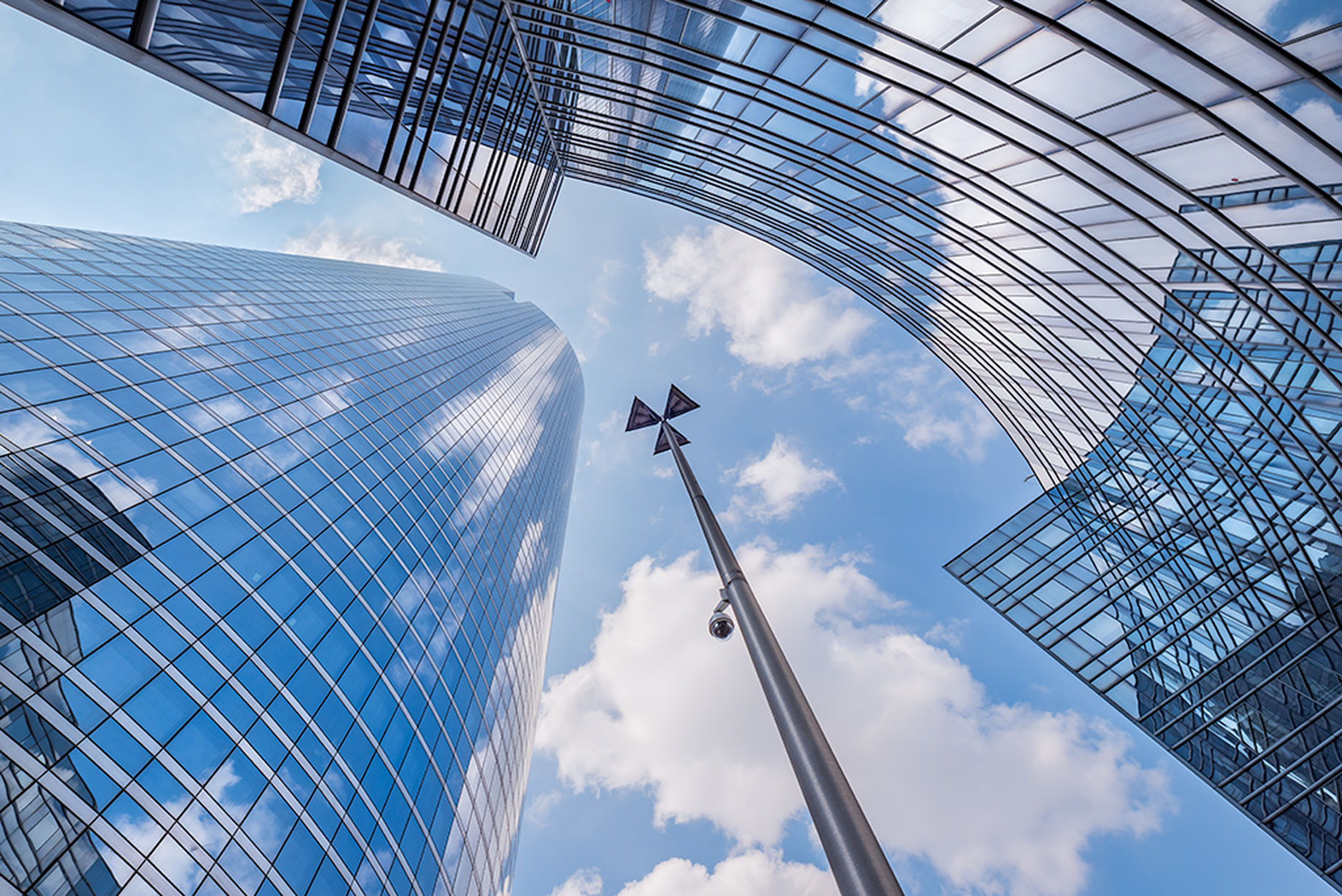 architecture, cloud - sky, low angle view, sky, built structure, building exterior, building, tall - high, office building exterior, nature, city, office, skyscraper, travel, tower, modern, day, air vehicle, glass - material, flying, no people, outdoors, directly below, financial district, aerospace industry