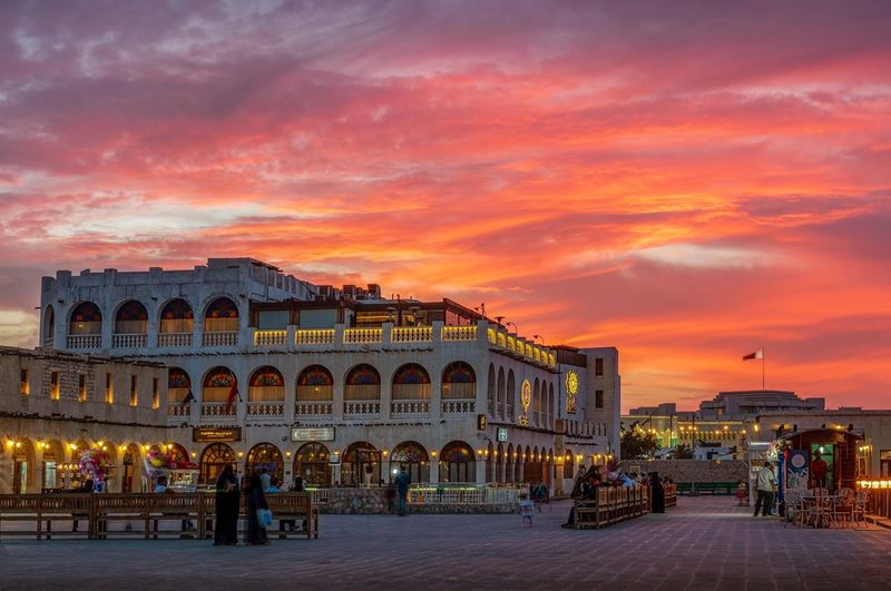 Fire sunset Souk Waqif Qatar Doha Architecture Building Exterior Built Structure Sky City Cloud - Sky Travel Destinations Illuminated Sunset Nature Night Building Street Town Tourism Orange Color Incidental People Travel Outdoors
