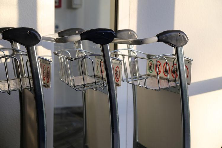 Close-up of luggage carts