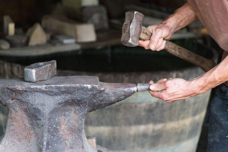 Cropped Hands Of Man Working In Workshop