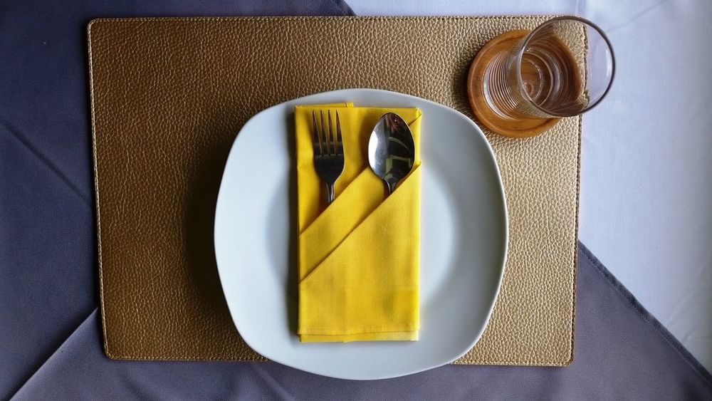 Day Dinner Dinner Time Drinking Drinking Glass Drinking Water Food Foods Fork Fork Glass High Angle View Hotel Restaurant Lunch Meal Meal Time Plate Restaurant Spoon Thai Thailand Top View Top View Of Drink Top View Of Food Yellow